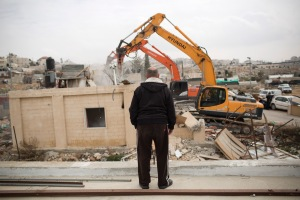<p> A member of the Adgluni family watching his house being demolished by Israeli authorities, East Jerusalem, January 27, 2014. The Israeli authorities claimed the house was built on lands that do not belong to the family.</p>